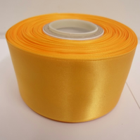 1 roll of 50mm Marigold, Dark Yellow satin ribbon, 25 metres, double sided