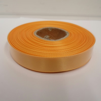 2 metres of 15mm light orange satin ribbon, double sided