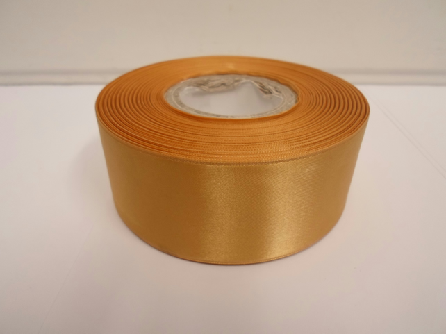 1 roll of 38mm yellow gold satin ribbon, 25 metres, double sided