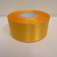 2 metres of 38mm Marigold, Dark Yellow satin ribbon, double sided