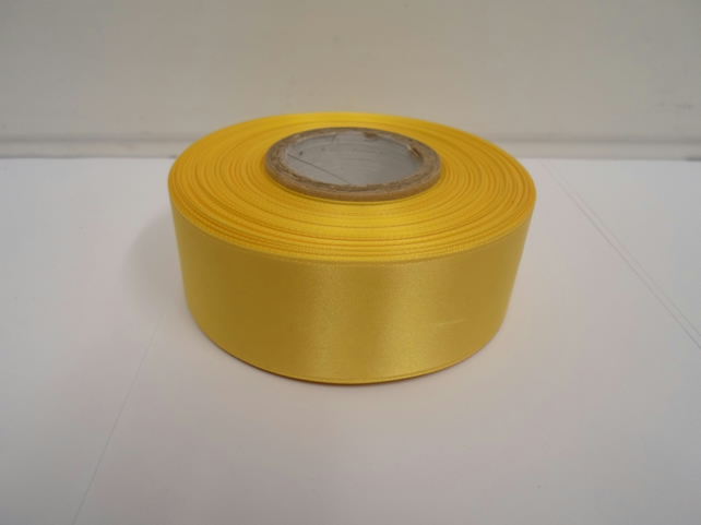 2 metres of 38mm Canary, bright yellow satin ribbon, double sided