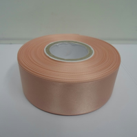2 metres of 38mm peach, light orange satin ribbon, double sided