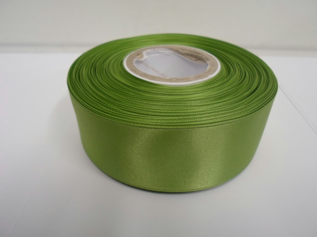 2 metres of 38mm sage, light green satin ribbon, double sided
