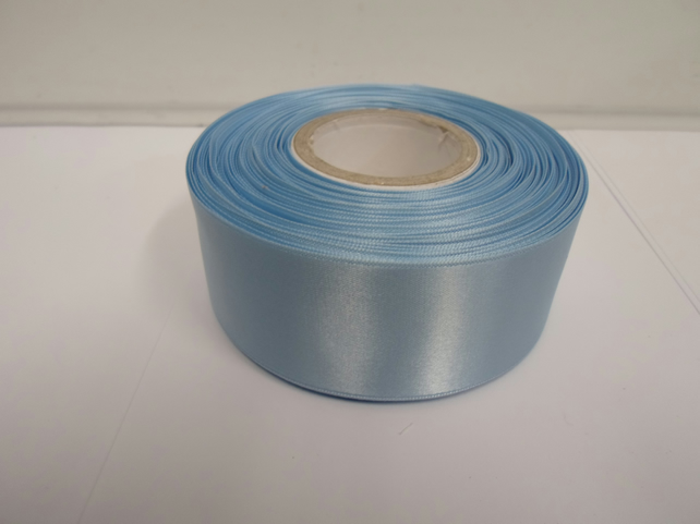 2 metres of 38mm baby light blue satin ribbon, double sided