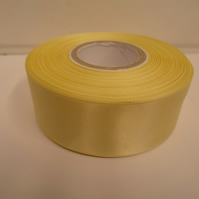 2 metres of 38mm Lemon, light yellow satin ribbon, double sided
