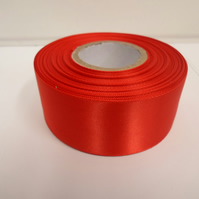 2 metres of 38mm scarlet, bright red satin ribbon, double sided