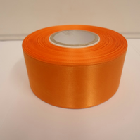 2 metres of 38mm light orange satin ribbon, double sided