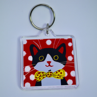 LITTLE BLACK AND WHITE HAPPY CAT KEYRING WITH RED BACKGROUND-POSTAGE FREE