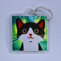 LITTLE BLACK AND WHITE HAPPY CAT KEYRING WITH GREEN BACKGROUND-POSTAGE FREE