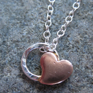 "Teeny Little Sweet Heart Necklace on 18"" sterling silver Chain"