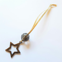Antique brass coloured star and smokey grey glass bead decoration