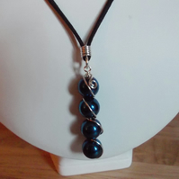 Electric Blue Haematite wire wrapped pendant