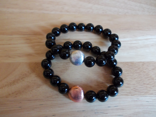 Black agate elasticated bracelets with copper coin charms