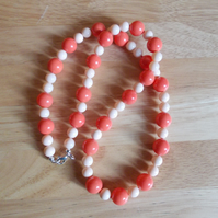 Coral and creamy peach coloured shell pearl necklace