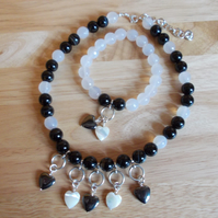 Monochrome heart charm necklace and bracelet set