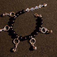 Agate bracelet with silver coated quartz and haematite charms