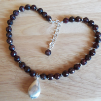 Garnet necklace with brushed silver plated copper teardrop pendant