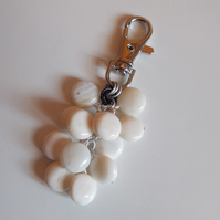 White shell coin bag charm