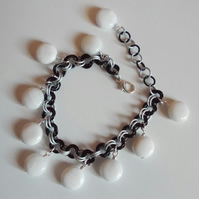 Monochrome chainmaille bracelet with shell coin charms