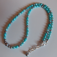 Teal freshwater culture pearl and silver shell pearl necklace