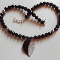 Agate bead necklace with glass leaf pendant