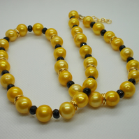 Golden freshwater cultured pearl and black agate necklace