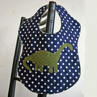 "Dinosaur ""Eat your Greens"" spotty bib"