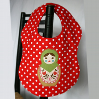 Matryoshka spotty bib (green)
