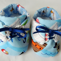 Blue Baby Shoes with a Pirate Pattern for a New Born