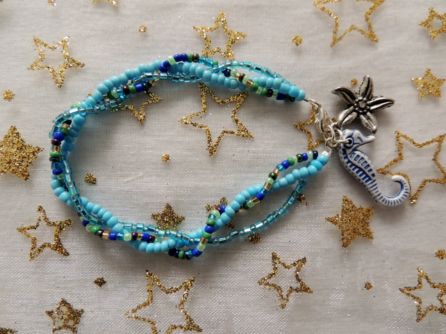 Glass Bead Bracelet with Starfish and Seahorse Charms