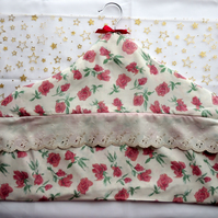 Covered Coat Hanger with Hidden Zipped Pocket in a Pink Rose Pattern