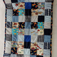 Blue Patchwork Cot Bed Quilt Throw with a Transport Theme.