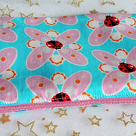 Blue and Pink Pencil Case with a design of Ladybird and Flowers