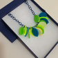 One-off colour way petal necklace - blues, greens, yellows.