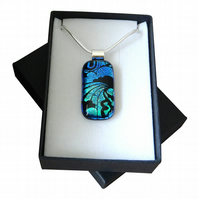 HANDMADE FUSED DICHROIC GLASS TURQUOISE BLUE 'LOONY TOON' PENDANT.