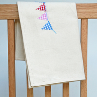 Cotton tea towel with appliqued bunting