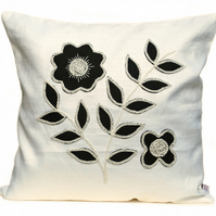White cushion with wool felt floral design