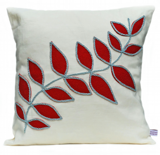 Linen cushion with red leaf design