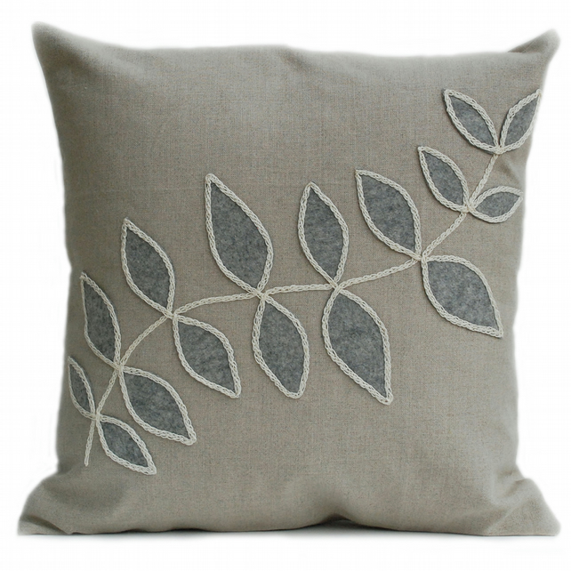 Linen cushion with grey leaf design