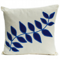 Cream linen cushion with blue felt leaf design