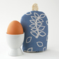 Blue leaves egg cosy