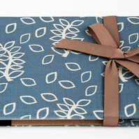 Blue leaves covered notebook