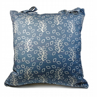 Blue leaves sofa cushion with ties detail