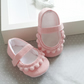 Pink linen mary Jane baby girls shoes, with pompom trim.