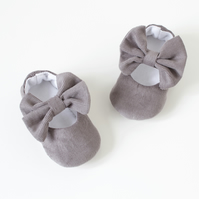 Grey corduroy baby girls shoes with bow on strap