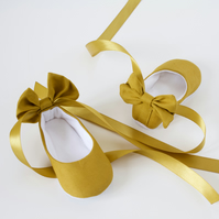 cotton mustard baby girls ballet shoes, with ribbon tie and bow