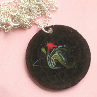 round pendant - scrolled red, white, green over black