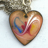 heart pendant - scrolled blue, white, red, yellow over golden brown