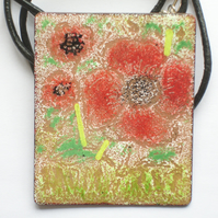 large oblong pendant on thong - poppies