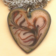 heart pendant - scrolled red and brown over golden brown